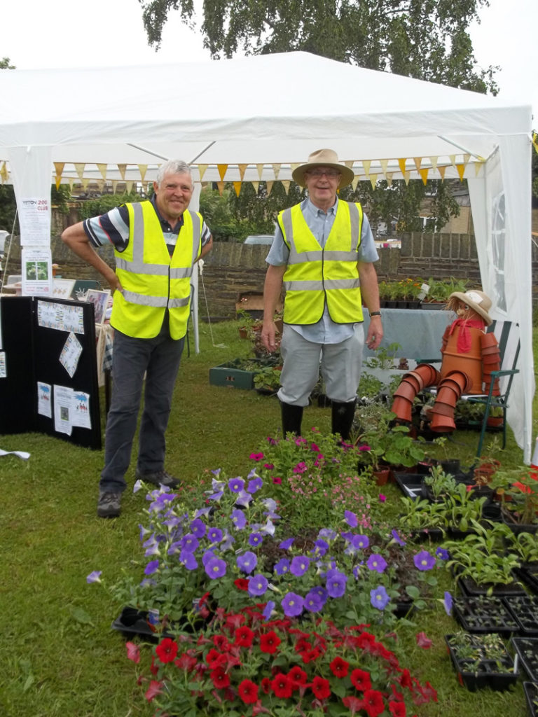 Two of YT's stalwart gardeners manning the plant stall - aided by Dougie - the flowerpot man!