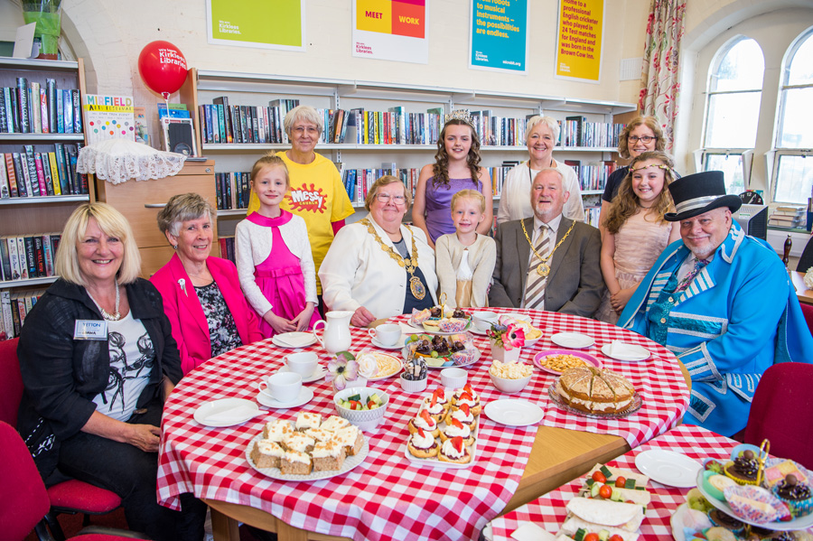 Guests at tea in the library