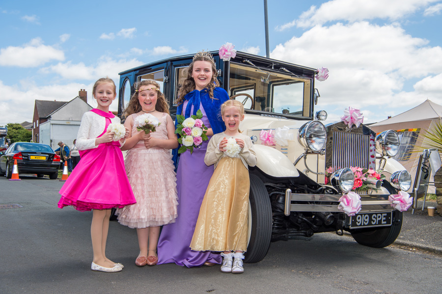 Queen and attendants outside car