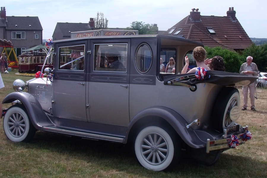 The Gala Queen's car arrives at the field.