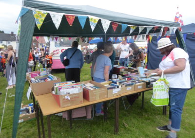 Choosing a book from Friends of Kirkheaton Library stall